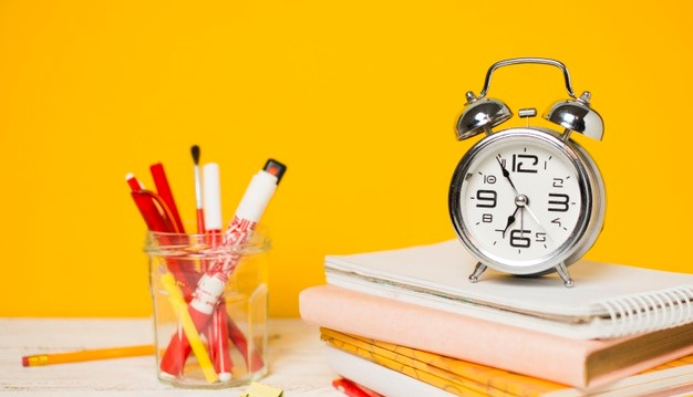 back-school-concept-clock-pile-books_23-2148224243